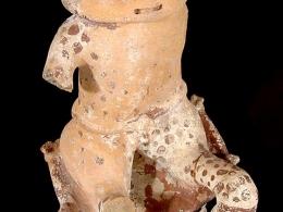 Figura zooantropomorfa masculina sentada